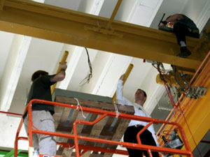 Professor Singhose (center) Helps Install an Oscillation Control System to the MARC Building Crane