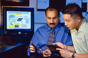 Dr. Suresh Sitaraman and George Lo (B.S. University of Washington, M.S. Georgia Tech) are discussing microvia processing and reliability for electronics packaging applications.