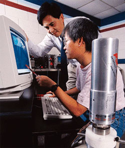 Professor Chris Wang and Lisa Chiang (B.S., University of Pittsburgh) at the high-priority germanium gamma ray spectrometer system, which identifies trace quantities of unknown radionuclides in environmental or forensic samples.