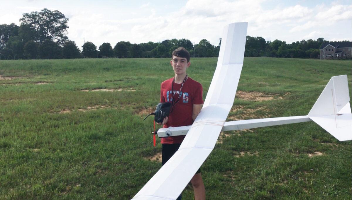 Aidan Albers with a UAV he built