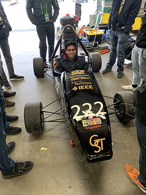 Ajay in the HyTech competition vehicle