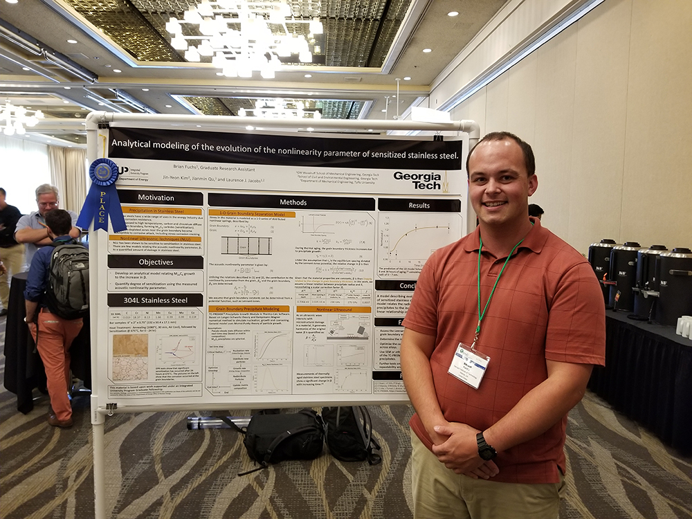 Brian Fuchs in front of his prize-winning poster