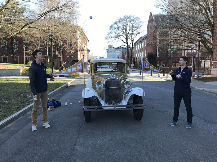 Max Poff (left) and Ethan Rosman (right) juggling in front of the Wreck