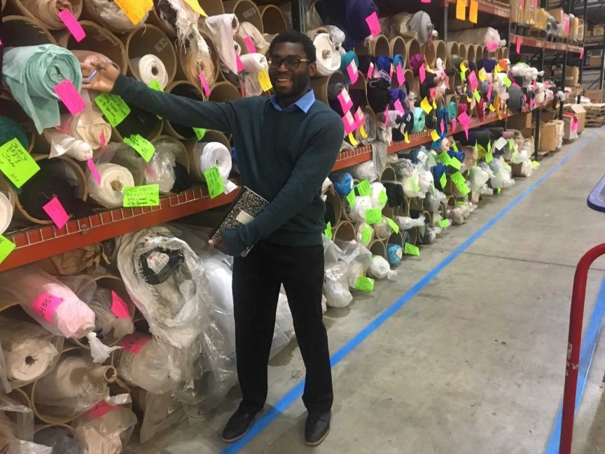 Team member with fabric roles at Hanes factory