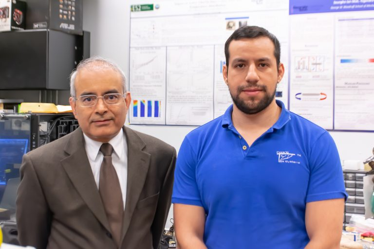 Yogendra Joshi (left) and Daniel Lorenzini stand in Joshi's lab heat transfer, combustion and energy systems lab
