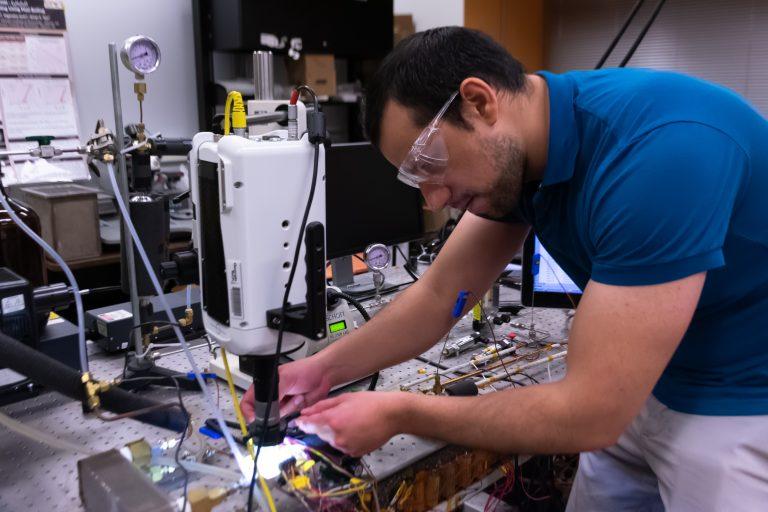Daniel Lorenzini prepares to test a microchip