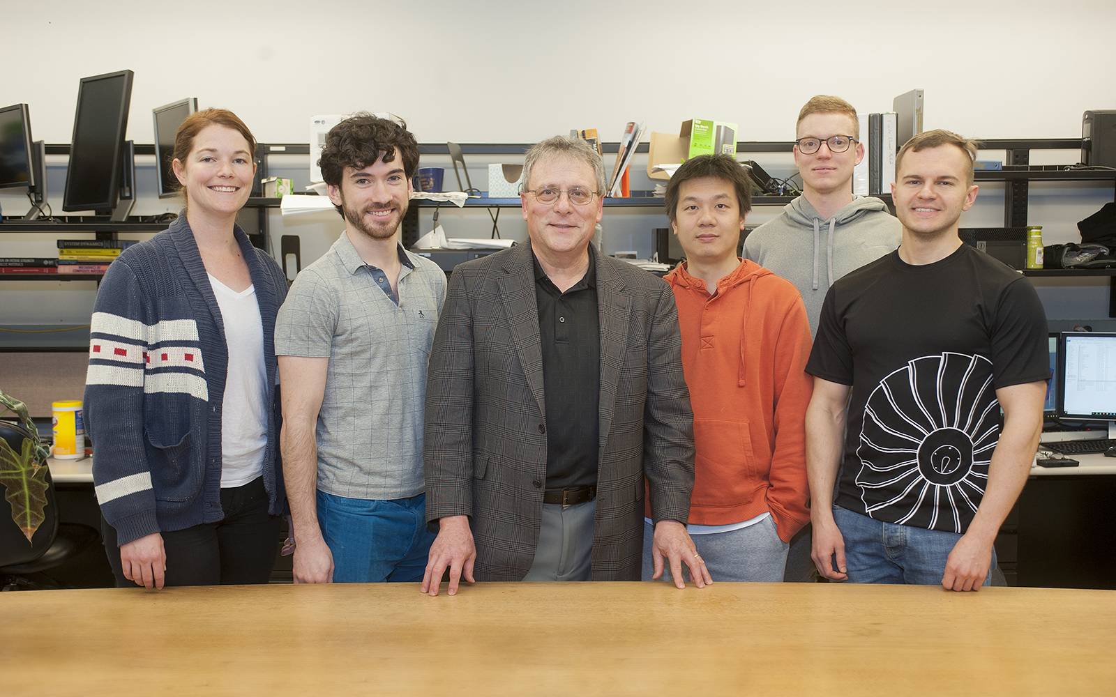 Professor David McDowell with students during a National Robotics Week tour of his lab in 2018. Pictured (L-R): Adrienne Muth, Aaron Tallman, McDowell, Dengke Chen, Theodore Zirkle, and Krzysztof Stopka.