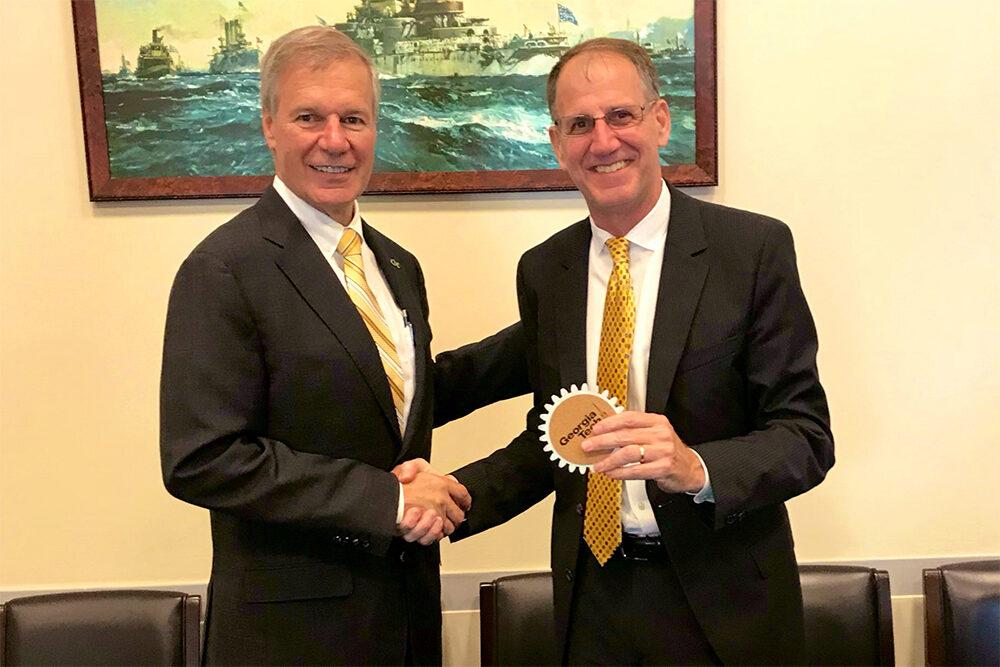 President Bud Peterson presents a coaster to Dave Sienicki