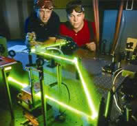 Matt Cornwell (B.S. Duke University, M.S. Georgia Tech) and Mike Haberman (B.S. University of Idaho, M.S. Georgia Tech) monitoring the elastic moduli of paper using noncontact generation and detection of ultrasound with lasers to control the quality of paper products during production.