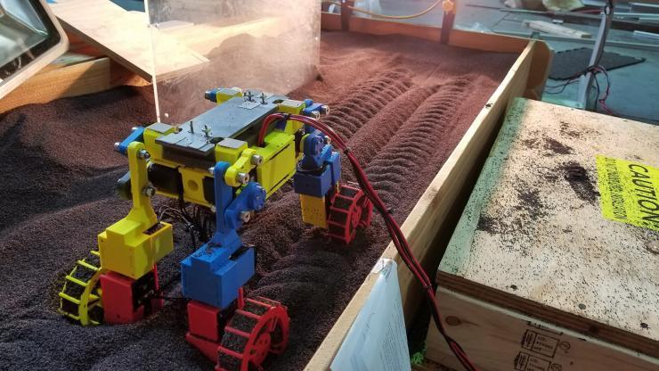 Mini Rover in laboratory track bed
