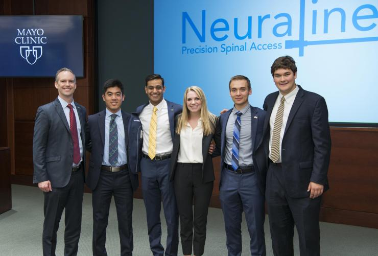 Team Neuraline and Dr. Rains: Pictured are (left to right), Professor of the Practice James Rains, and Capstone students Cassidy Wang, Dev Mandavia, Marci Medford, Lucas Muller, and Alex Bills.