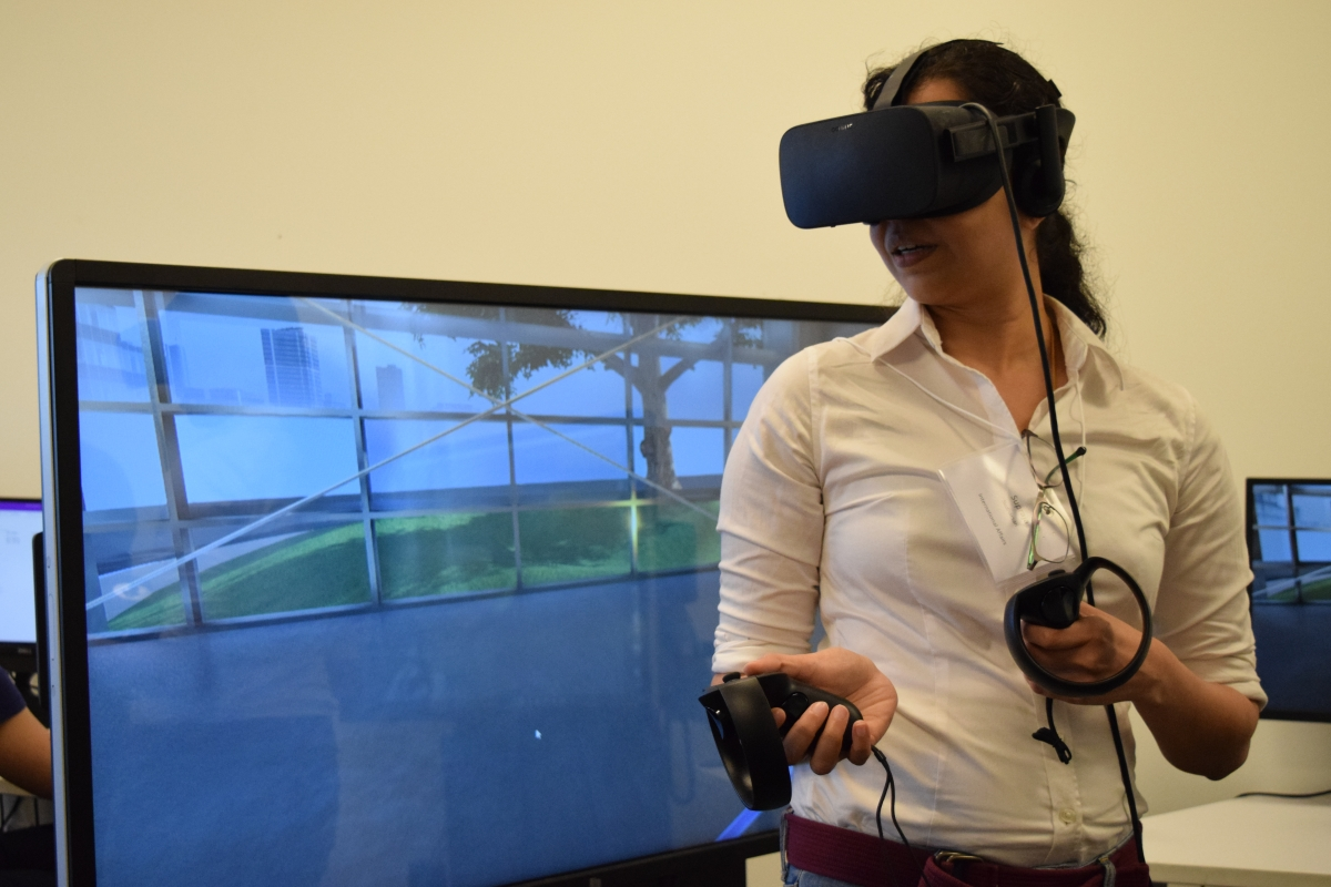 Woman with interactive goggles in front of testing screen
