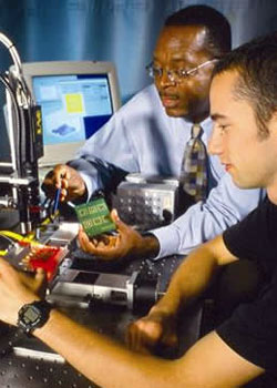 Dr. Charles Ume and Turner Howard (B.S. MIT, M.S. Georgia Tech) using a prototype microelectronics device inspection system used for identifying manufacturing defects in chips and solder bumps.