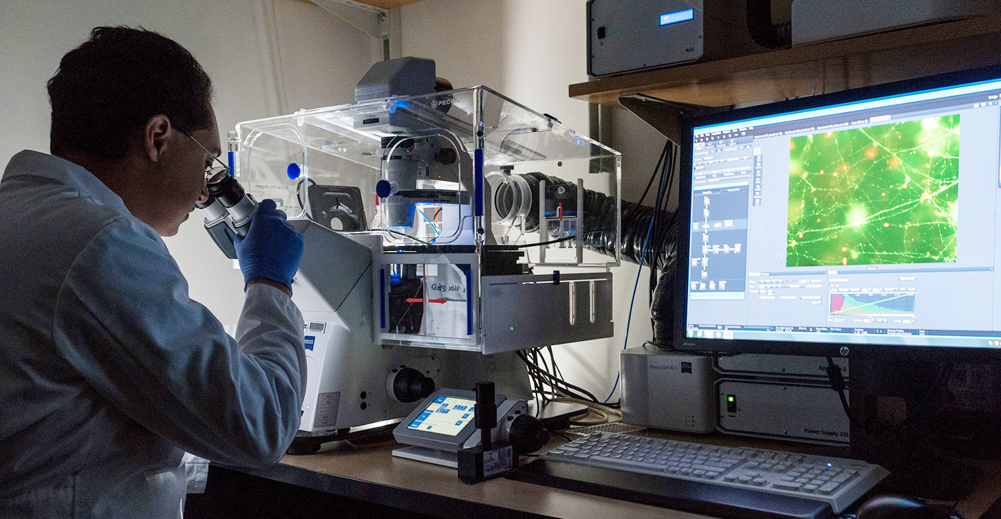 Georgia Tech assistant professor Levi Wood in his lab. Wood is a mechanical engineer who researches neurological diseases. In this photo, he is working on Alzheimer's disease. Credit: Georgia Tech / Rob Felt